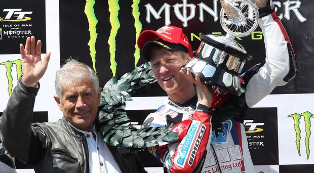 Gary Johnson (left) accepts TT trophy from legend Giacomo Agostini yesterday