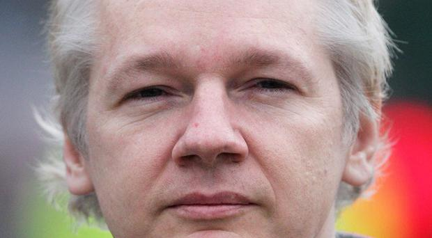 One of Julian Assange's lawyers has been given a warning by the Swedish bar association