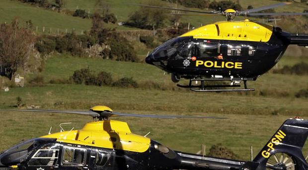 Police helicopters near the scene where a helicopter crashed in the Mourne Mountains in October