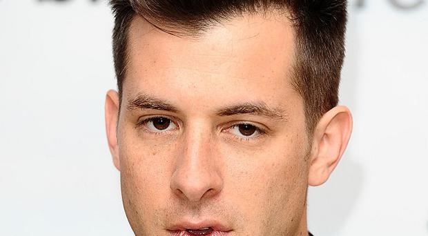 Mark Ronson has offered a big cash reward for the safe return of his bag