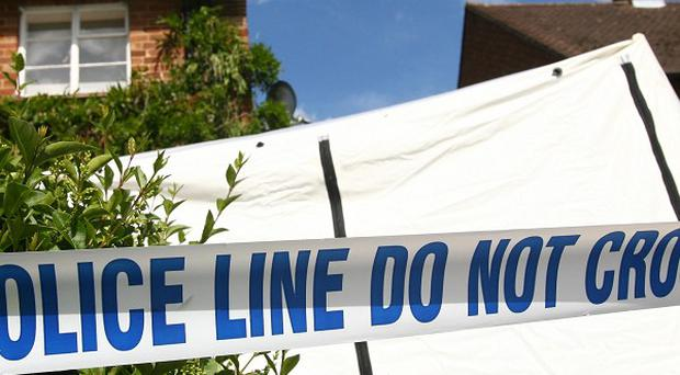 Police have identified a woman whose body was found at a house in south Belfast