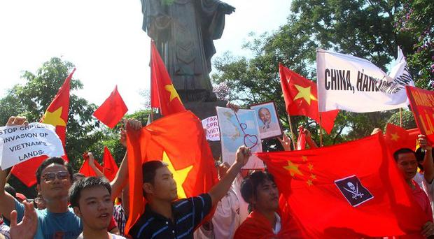 Protesters in Hanoi demand that China stay out of Vietnamese waters after a spat involving an oil-drilling research boat in the South China Sea (AP)
