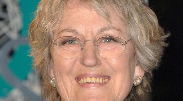 Germaine Greer is under pressure to apologise after she suggested that British troops might take part in rapes if they are sent into Libya