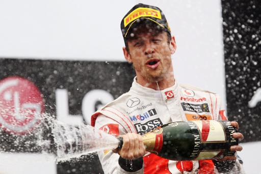 MONTREAL, CANADA - JUNE 12: Jenson Button of Great Britain and McLaren celebrates on the podium after winning the Canadian Formula One Grand Prix at the Circuit Gilles Villeneuve on June 12, 2011 in Montreal, Canada. (Photo by Clive Rose/Getty Images)
