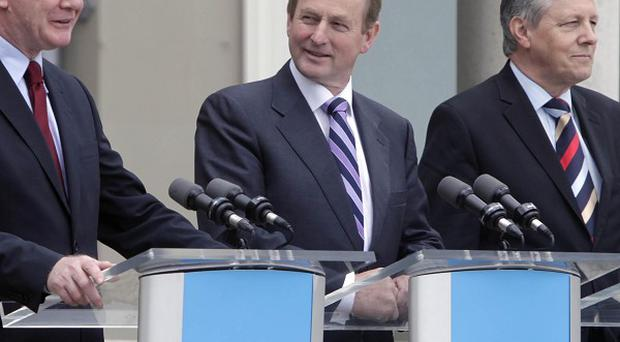 Martin McGuiness, Enda Kenny and Peter Robinson at the North South Ministerial Council meeting in Dublin