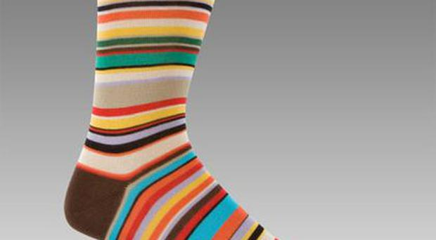<b>1. Paul Smith Socks</b><br /> You can't go far wrong with a pair of socks. This cotton pair from Paul Smith features the designer's characteristically quirky coloured stripes. Price: £17.99 paulsmith.co.uk
