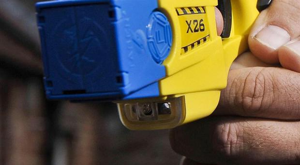Two masked men attempted to hold up a shop with taser stun guns in Northern Ireland