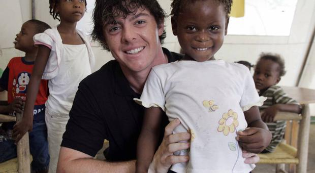 Rory McIlroy was touched by the spirit of the people of Haiti whose fight for survival puts the Holywood man's golfing concerns firmly into perspective