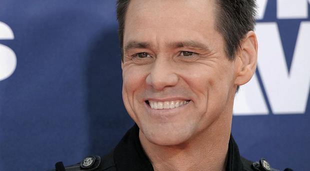 Jim Carrey says being a good parent can be tough
