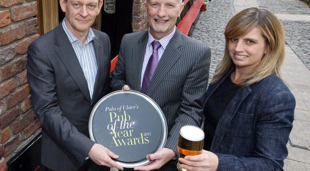 Launching the Pub of the Year Awards are (from left) Paul Connolly, managing editor of the Belfast Telegraph, Colin Neill, chief executive of Pubs of Ulster and Sorcha Wolsey, chair of Pubs of Ulster.
