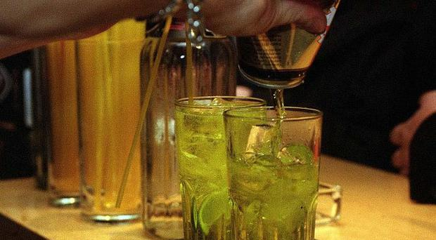 A woman has been left paralysed following a row in a pub over a spilled drink