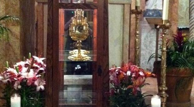 The 780-year-old religious relic of Saint Anthony, the patron saint of lost causes and missing objects, centre in cabinet, that was stolen from a church(AP)