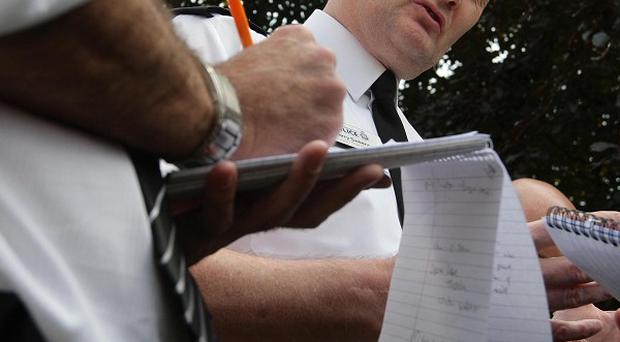Assistant Chief Constable of Greater Manchester Police, Terry Sweeney, talks to reporters about the raids