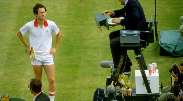 John McEnroe of the USA argues with the umpire during Wimbledon in 1982