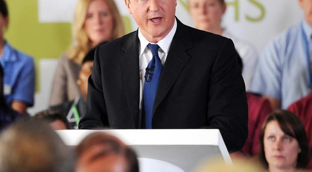 David Cameron said the Government 'had listened' to concerns about NHS reform as visited Guys Hospital in London