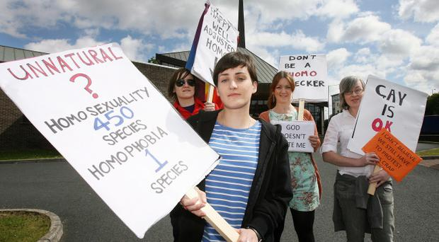 Nuala McGreevey, Niamh Rowan, Harriot Long and Deby McKnight picket Belvoir Church during yesterday's conference