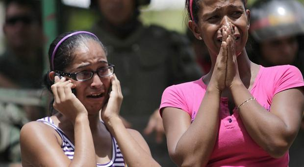 Inmates' relatives cry outside Rodeo I prison as they wait for news after a riot at the prison in Guatire on the outskirts of Caracas, Venezuela