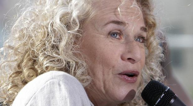 Songwriter Carole King has signed a book deal for her life story (AP)