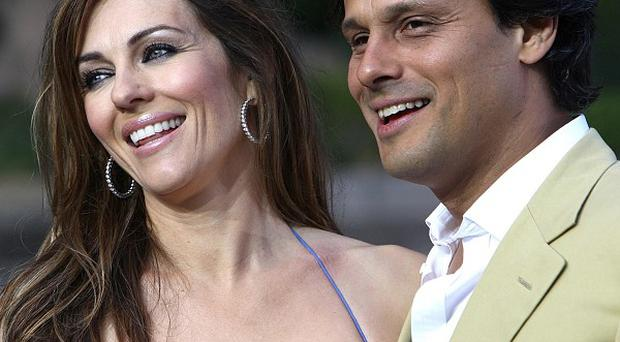 Elizabeth Hurley and Arun Nayar's four-year marriage has ended in divorce