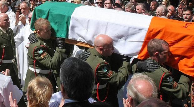 The coffin of former Finance Minister Brian Lenihan is carried from St Mochta's Church in Porterstown, Dublin, after funeral mass