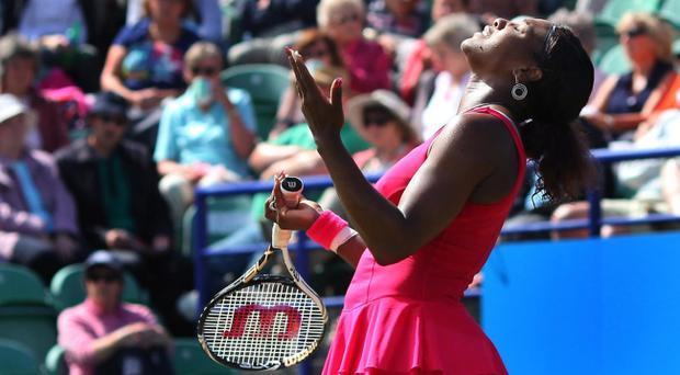 Serena Williams misses a point during her defeat to Vera Zvonareva in Eastbourne