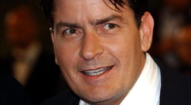 Charlie Sheen's legal action over his firing from hit show Two And A Half Men should be handled through private arbitration, a judge says
