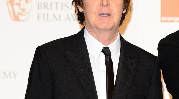 Sir Paul McCartney is re-releasing his first solo album