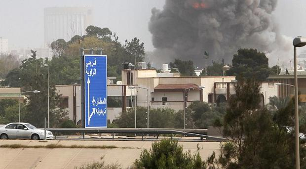 Anti-Gaddafi activists say they are emboldened by the Nato strikes which have been pounding the capital (AP)
