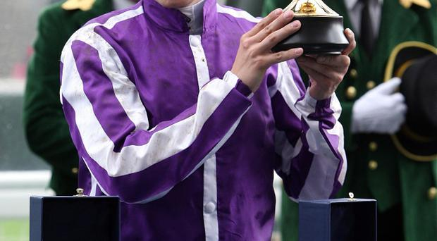 Jamie Spencer with his trophy after winning the Gold Cup on Fame And Glory on day three of Royal Ascot