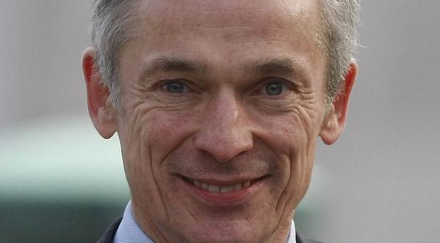 Richard Bruton said long-term unemployment and emigration continue to be a drain on the economy