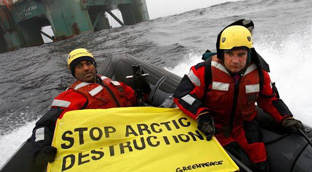 Greenpeace activists protest in waters off Greenland (AP/Greenpeace International)