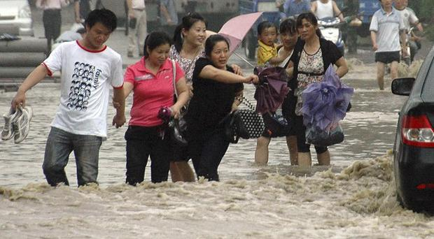 Flooding in China over the past two weeks has left more than 170 people dead or missing (AP)
