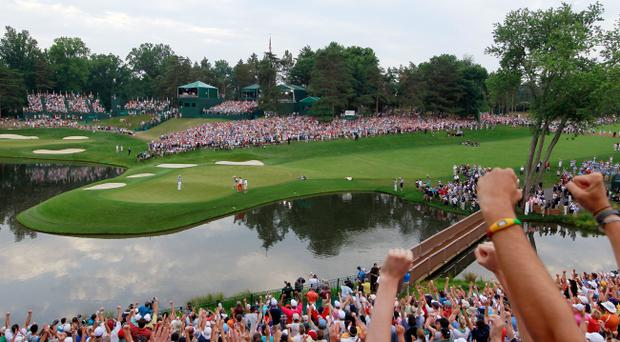 BETHESDA, MD - JUNE 19: Golf fans cheer as Rory McIlroy of Northern Ireland celebrates his eight-stroke victory on the 18th green to win during the 111th U.S. Open at Congressional Country Club on June 19, 2011 in Bethesda, Maryland. (Photo by Chris Trotman/Getty Images)