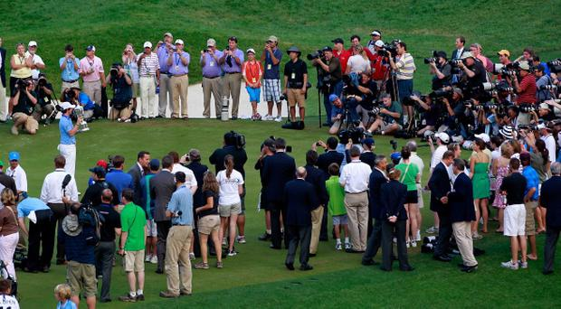 BETHESDA, MD - JUNE 19: Rory McIlroy of Northern Ireland poses with the trophy for photographers after his eight-stroke victory on the 18th green during the 111th U.S. Open at Congressional Country Club on June 19, 2011 in Bethesda, Maryland. (Photo by Chris Trotman/Getty Images)