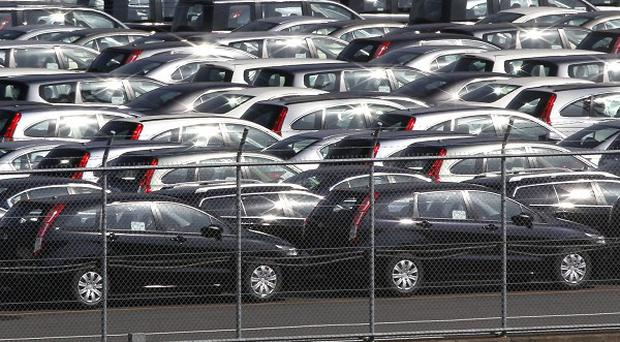 Hundreds of Japanese vehicles parked before being loaded on a freighter in Yokohama near Tokyo, Japan