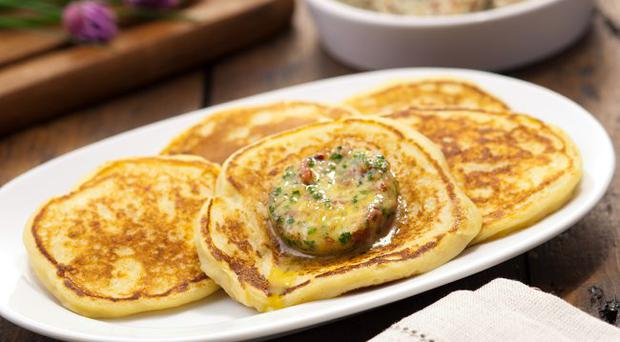 Potato pancakes with crispy bacon and chive butter