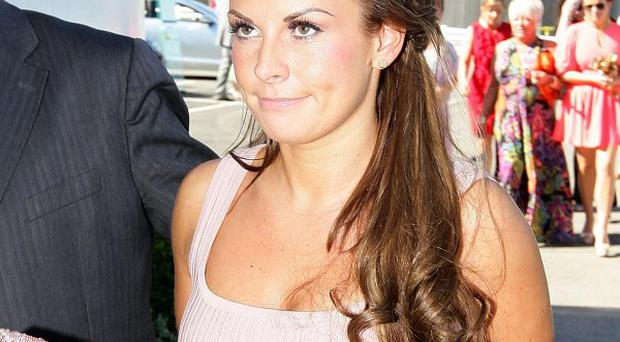 Three people have appeared in court accused of trying to blackmail Coleen Rooney