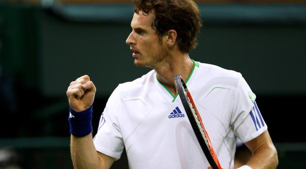 LONDON, ENGLAND - JUNE 20: Andy Murray of Great Britain reacts during his first round match against Daniel Gimeno-Traver of Spain on Day One of the Wimbledon Lawn Tennis Championships at the All England Lawn Tennis and Croquet Club on June 20, 2011 in London, England. (Photo by Clive Brunskill/Getty Images)