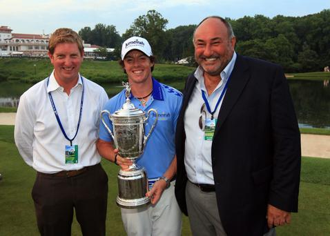 BETHESDA, MD - JUNE 19: Rory McIlroy of Northern Ireland holds the trophy next to Stuart Cage (L) and Andrew 'Chubby' Chandler after his eight-stroke victory during the 111th U.S. Open at Congressional Country Club on June 19, 2011 in Bethesda, Maryland. (Photo by David Cannon/Getty Images)