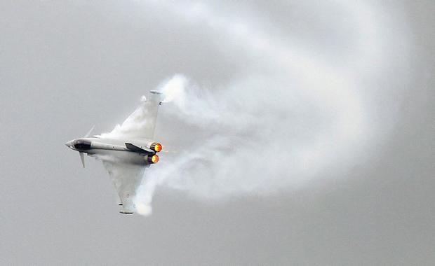 A Eurofighter Typhoon performs its demonstration flight on the first day of the Paris air show