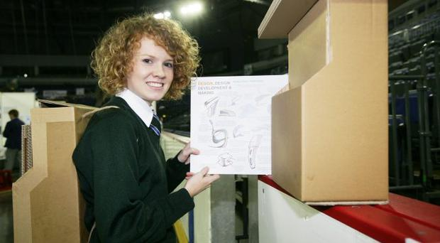Lucy Mulholland of Grosvenor High School displays her School-In-a-Box project — a transportable seat and school desk aimed at school's in the developing world