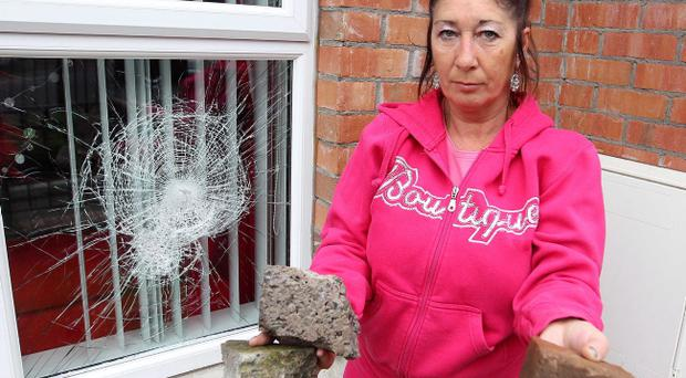 Lower Newtownards Road resident Anne-Marie Shanks pictured at the front of her, which faces the Short Strand, beside windows which were smashed during the trouble.
