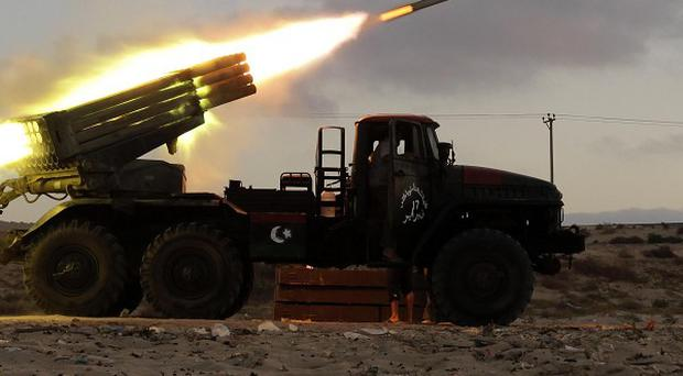 Rebel fighters launch a Grad rocket at the front line west of Misrata, Libya (AP)