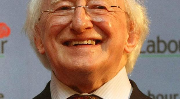 Michael D Higgins smiles after winning the Labour Party nomination to run as its candidate for the presidential election