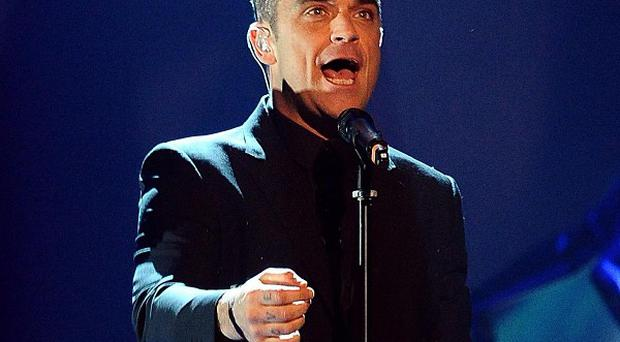 Robbie Williams reportedly flashed at the crowd