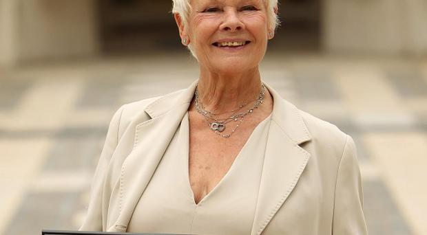 Dame Judi Dench collected her honour at a special ceremony in the capital