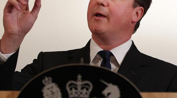 David Cameron insists his Government is strong despite high-profile policy U-turns
