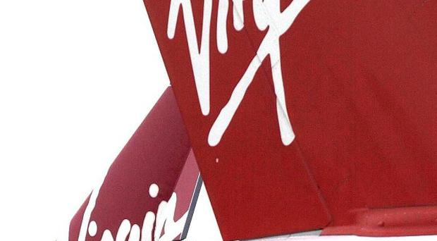Virgin Atlantic pilots have voted by a massive 97 per cent to go on strike in a row over pay