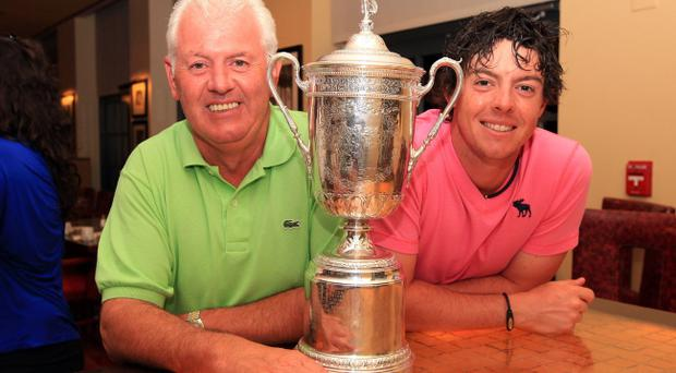 BETHESDA, MD - JUNE 19: Rory McIlroy of Northern Ireland and his father Gerry McIlroy pose with the trophy after his eight-stroke victory during the 111th U.S. Open at Congressional Country Club on June 19, 2011 in Bethesda, Maryland. (Photo by David Cannon/Getty Images)