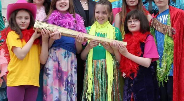 Sports Minister Caral Ni Chuilin at Stormont with performers from the BEAM and BEAT initiatives welcoming the arrival of the Olympic torch to Belfast yesterday